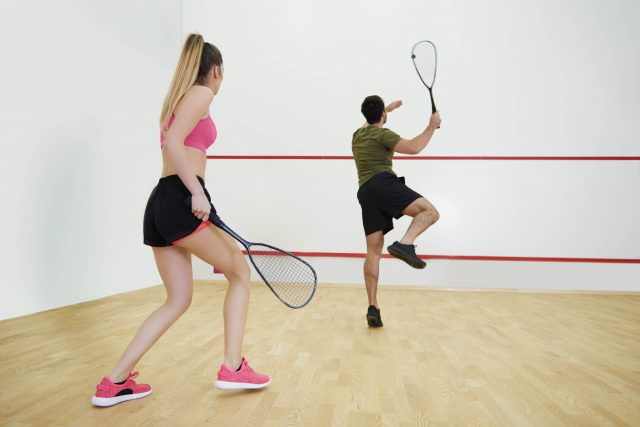 Rear view of couple during the squash game